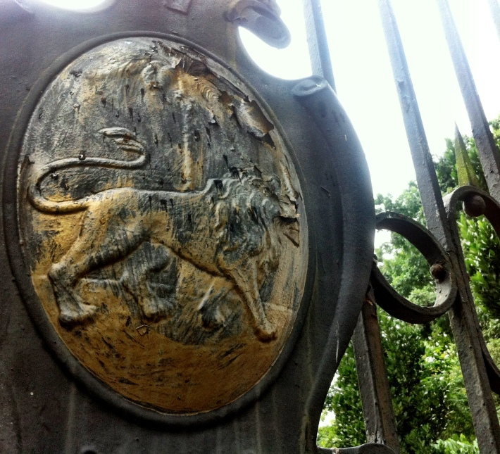 Gateposts bear the old Singapore Municipal Council emblem dating from the colonial era.