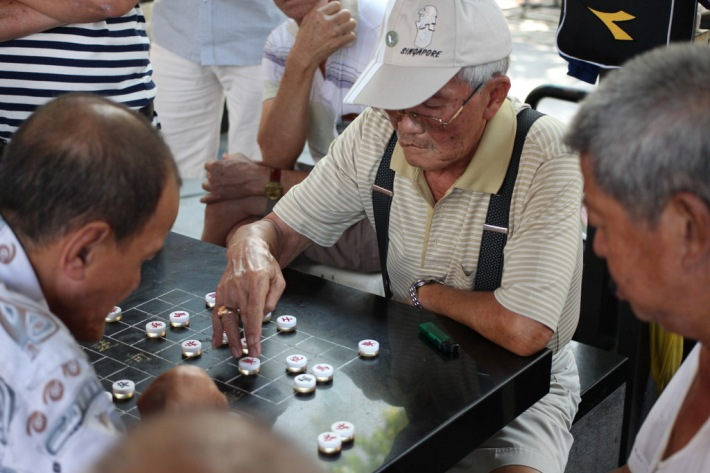 The uniquely designed Chinese chess tables provide a strategic spectacle for many a retiree