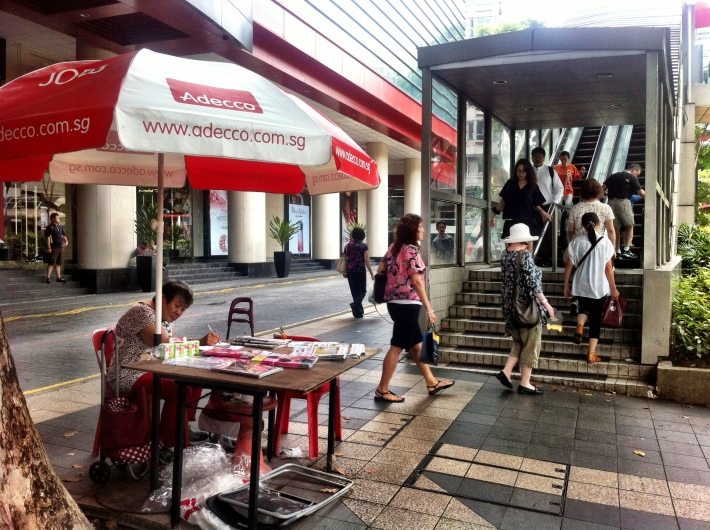 Roadside newspaper seller Pacific Plaza