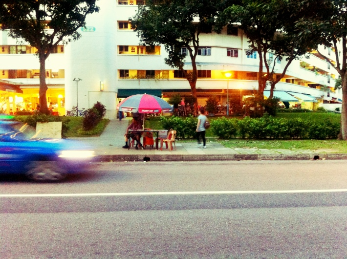 Wonder what must be going through the minds of these newspaper sellers as they watch the lives of people going by
