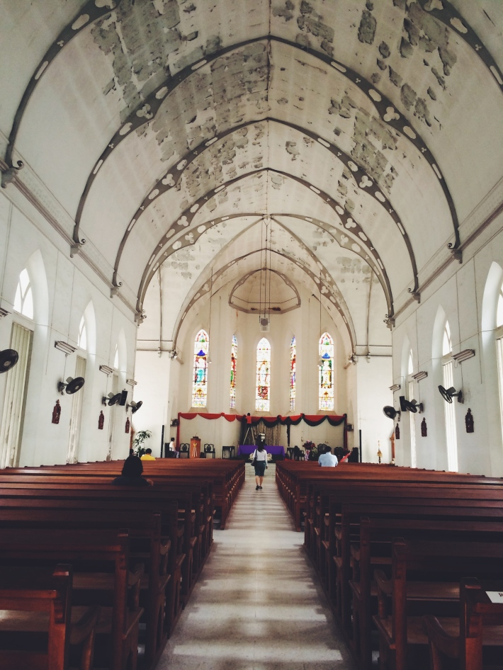The high arching ceiling of the church provides an encapsulating aura