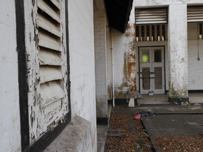 The weathered windowpanes and slated doors
