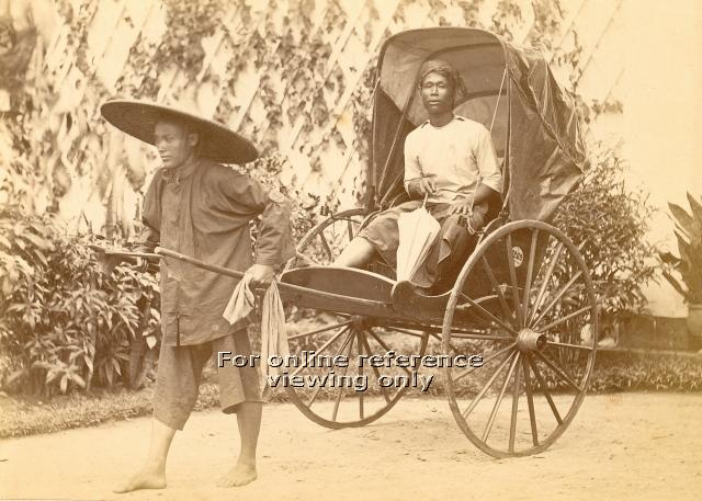 A rickshaw puller with a customer. Image taken from the National Archives of Singapore