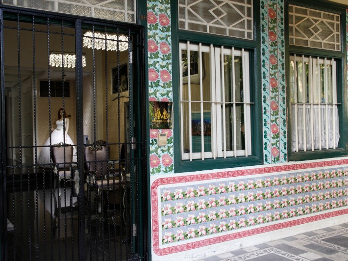 A bridal boutique lends a charm to the row of shophouses