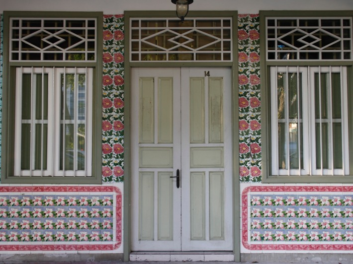 The abundant spanish floral ceramic tiles go nicely with the traditional shophouse symmetry