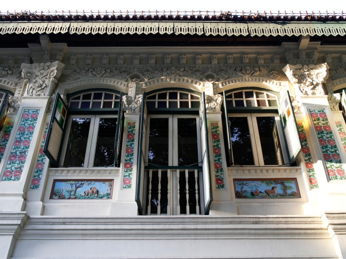 The second storey of the shophouses reveals multiple architectural influences from around the world. First are the chinese stucco panels featuring a phoenix below the windows, followed the distinctly Malay influenced eaves just below the roof, and finally the Baroque like floral cornices and friezes .
