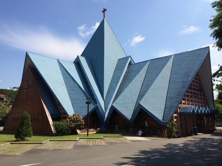 """The distinguishable blue slate roof of the church was constructed in folds in the shape of a tent to symbolise the """"tent of meeting"""" from the Bible's Old Testament. Some call this the 'origami church'"""
