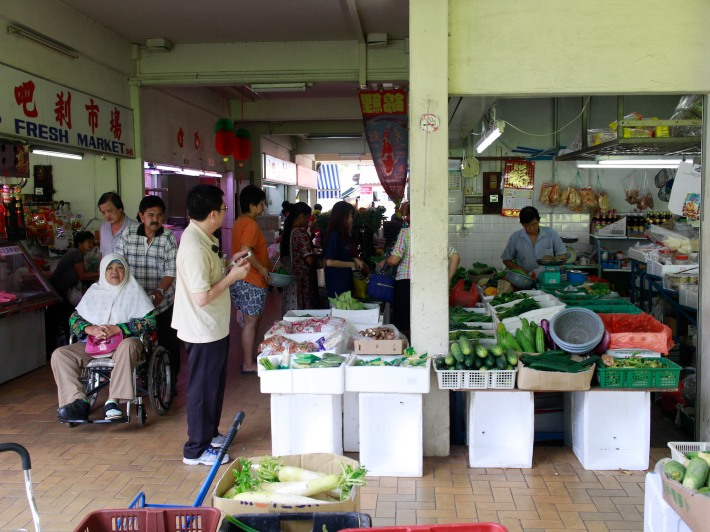 The kampung spirit is evident in Potong Pasir, with residents of all ages and races talking, laughing and smiling at one another.