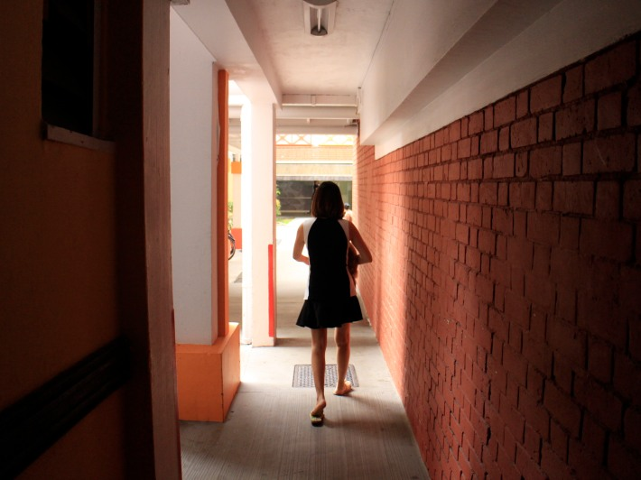 A woman walks through just one of the mazy paths that connect the corridors of block 1-3 & 4-6 together