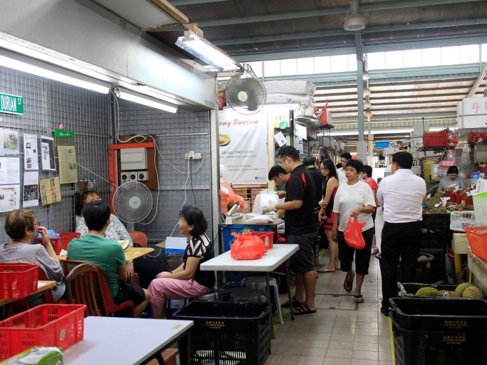 Residents enjoying some savoury durian and the wet market portion of the Ghim Moh Market