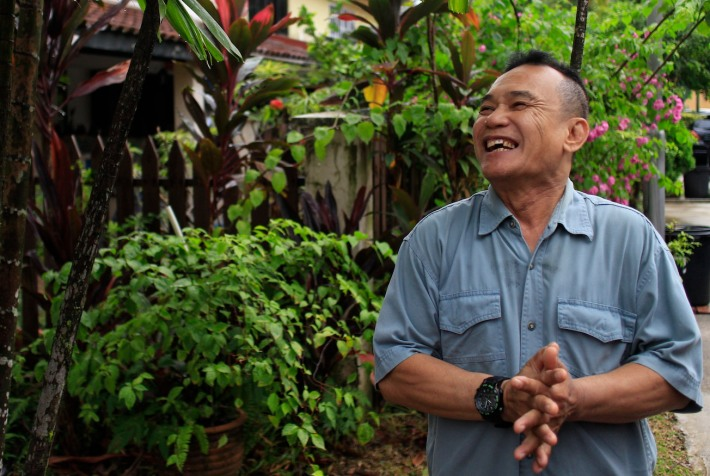 With a cheerful smile, Mr Mahmood Tamam, 63, shared with us the stories of his kampong like days while living in the unique HDB terrace house since 1965.