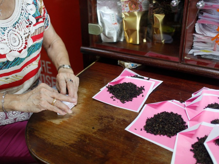 The tea leaves are wrapped in a traditional pink and white paper usually found in medical halls, this method helps to preserve the longevity of the tea and keeps alive the shop's cultural heritage as well