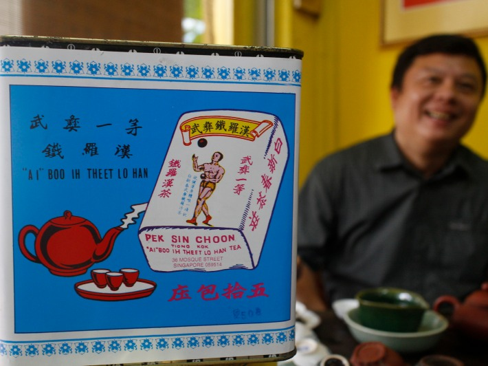 The Tie Luo Han铁罗汉- Iron Warrior Monk brand of tea is accompanied by an image of a physically fit man, emphasising the need for healthy living to ensure the benefits of tea are enhanced