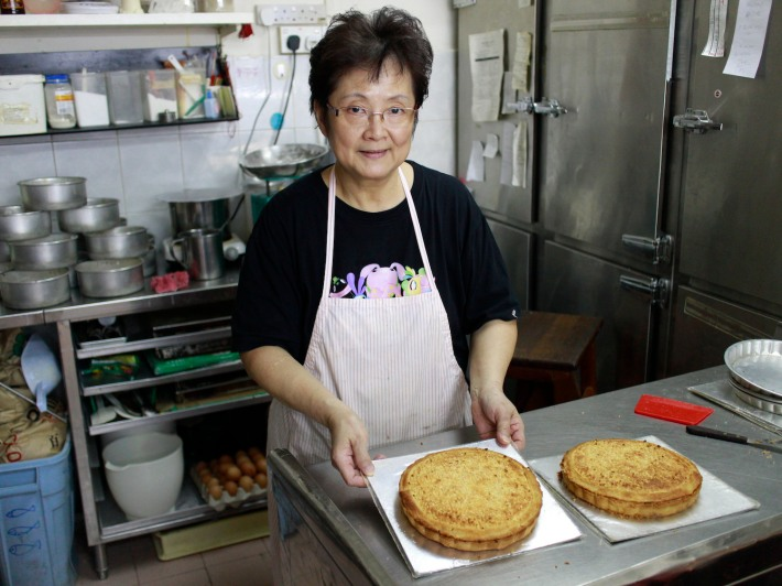 Dona Manis Cake Shop co-owner Mdm Soh Toh Lung with her world famous Banana Pie, made by hand from scratch every day.