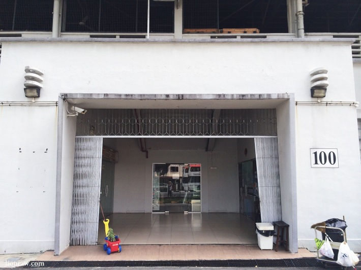 The shuttered entrance to the Old Singapore Badminton Hall now leads to Onsight climbing gym