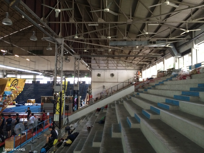 Hundreds of fans hang from the high sloped zinc roof of the Old Singapore Badminton Hall