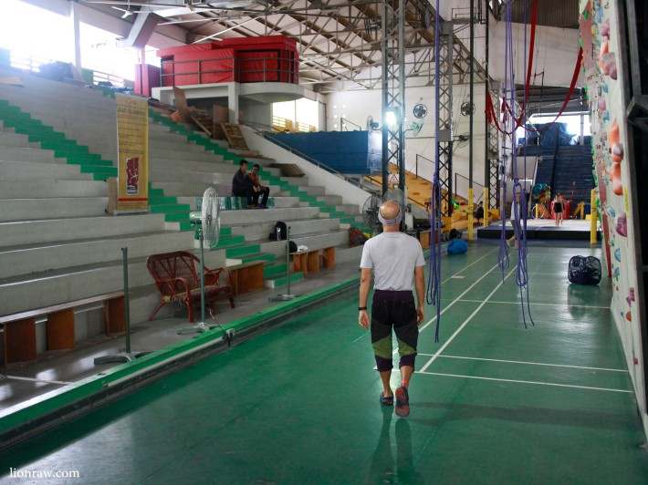 The layout of the badminton court can still be seen hidden below the rock climbing structures