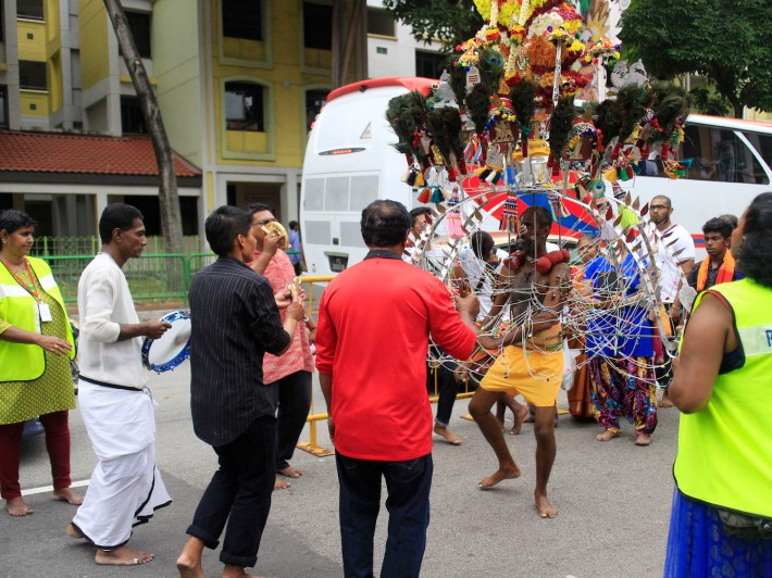 The support of friends and family is essential for Kavadi bearers. Here, song and dance is used to motivate the bearer to test the limits of his devotion.