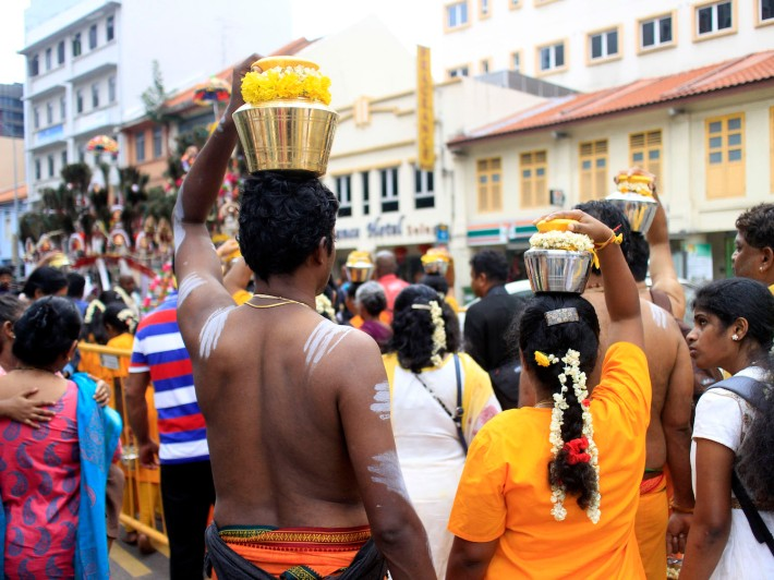Other devotees accompanying the bearers will sometime carry a milkpot on top of their heads along their journey to the temple.