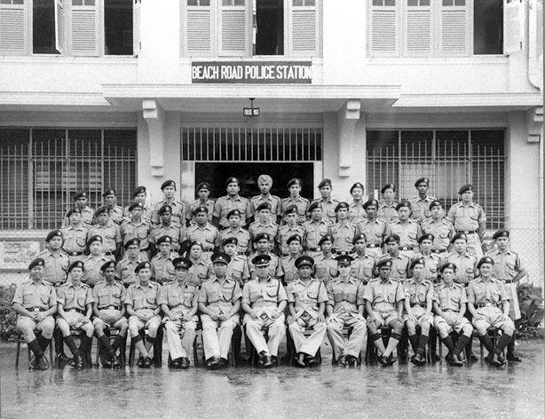 Officers posing outside the old Beach Road Police Station. Image from National Archives of Singapore.