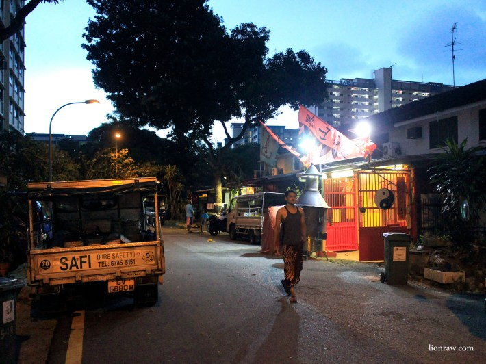 A foreign worker takes a relaxing stroll pass the many terrace houses around the area.