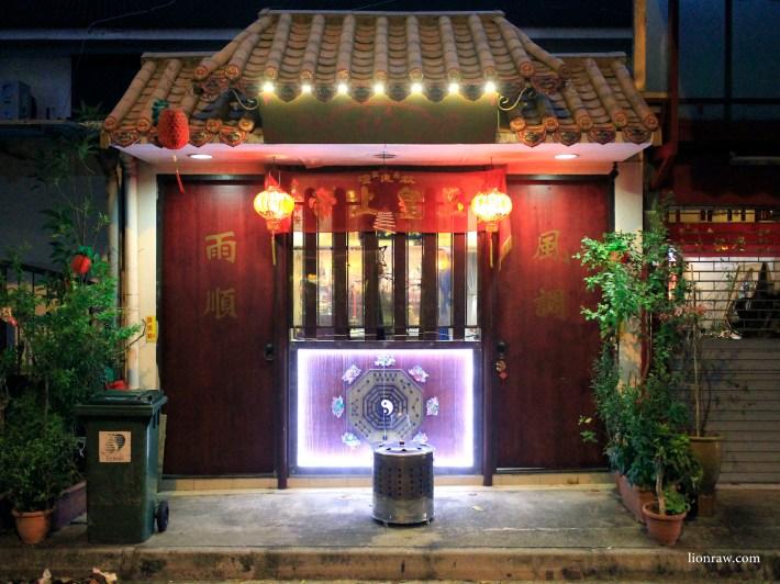 A taoist temple calls the kampong home.