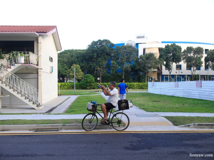 A passerby takes a snap of Dakota Crescent, a common activity for many visitors to the area nowadays.