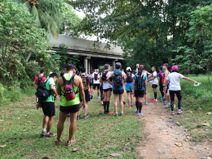 The Trail Running Singapore group gathers for an informal briefing before heading off on the trail