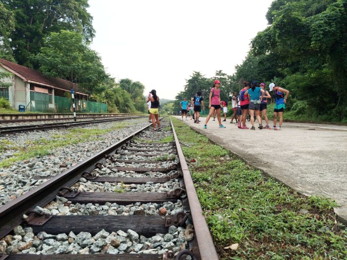 Runners stopping at the former Bukit Timah Station of the KTM Line, one of the many checkpoints throughout the run.