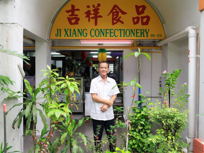 Mr Toh, 67, Towkay and CEO of Ji Xiang Confectionery (吉祥红龟果) stands proudly outside his stall that's been here at Everton Park since 1989.