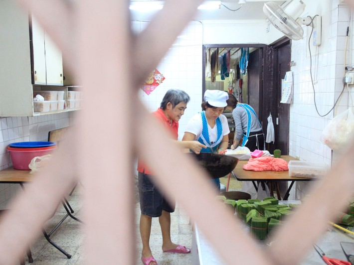 Mrs Toh, chief baker, brings a batch of the pastry skin to be cooled and seperated before the fillings are filled in