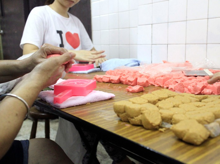 Many hands make light work. The staff totalling 16 sell upwards of 2,000 pieces of ang ku kueh a day!