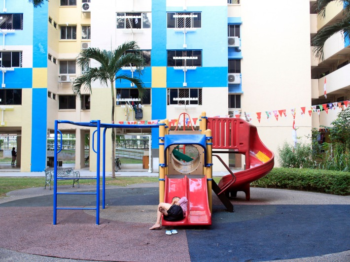 The rental flats along Hougang Avenue 3 are home to lower-income groups that sometimes spill out to the void deck and numerous amenities.