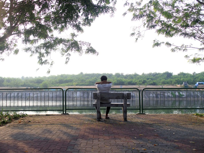 A man takes sometime to meditate at the Sungei Serangoon Park Connector, named as such because of the river that flows parallel to it.