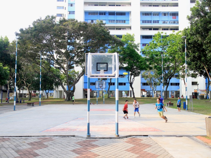 Kids enjoying a game of frisbee at one of the basketball courts in the neighbourhood.