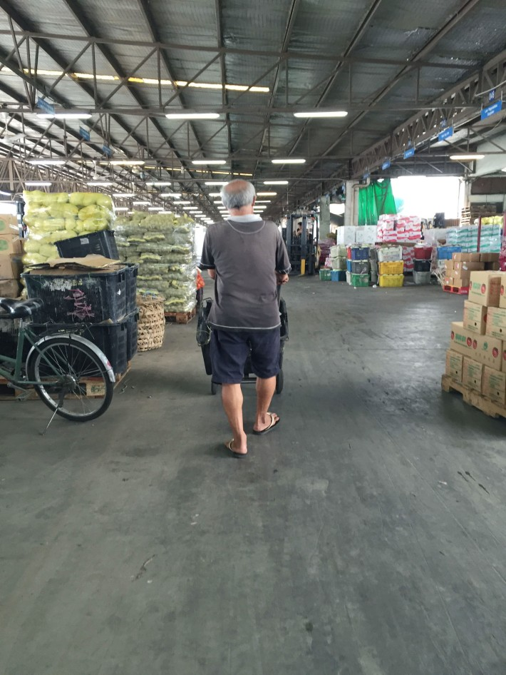 A wholesaler carts his produce across the near 430m expanse of the auction hall that can house over 300 stalls at any given time.