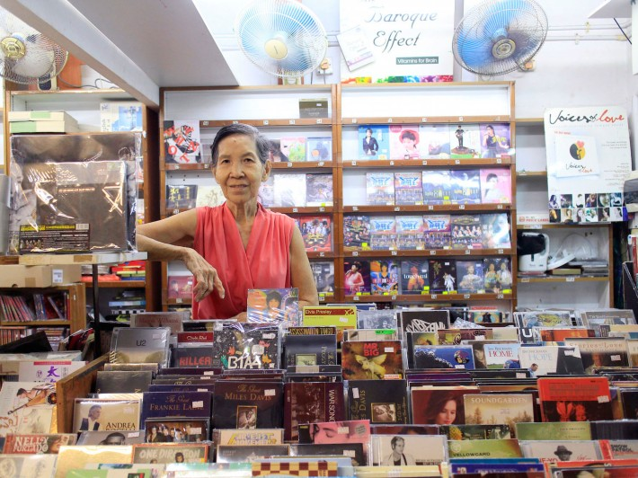 75-year old Mrs Wong stands proudly with the shopspace that she's called home for the past 32 years.
