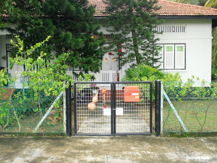 The homely entrance to a stretch of houses facing the soccer field of the PUB recreation centre