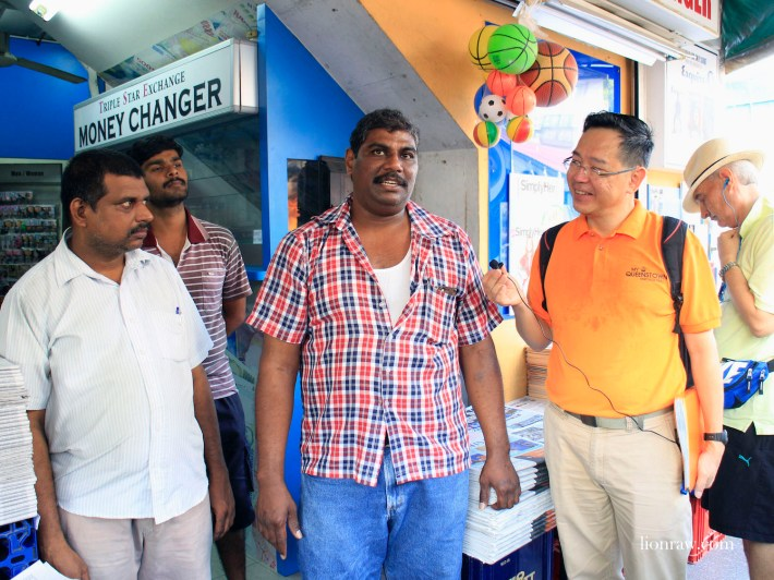 My Community tour leaders interacting with Sam, the third-generation owner of the institution that is Thambi Magazine Store.