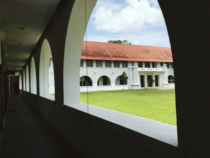 The arched corridors of the Federal Building are key features of the two storey houses that line the perimeter of the the upper green quadrangle of the old Raffles College.