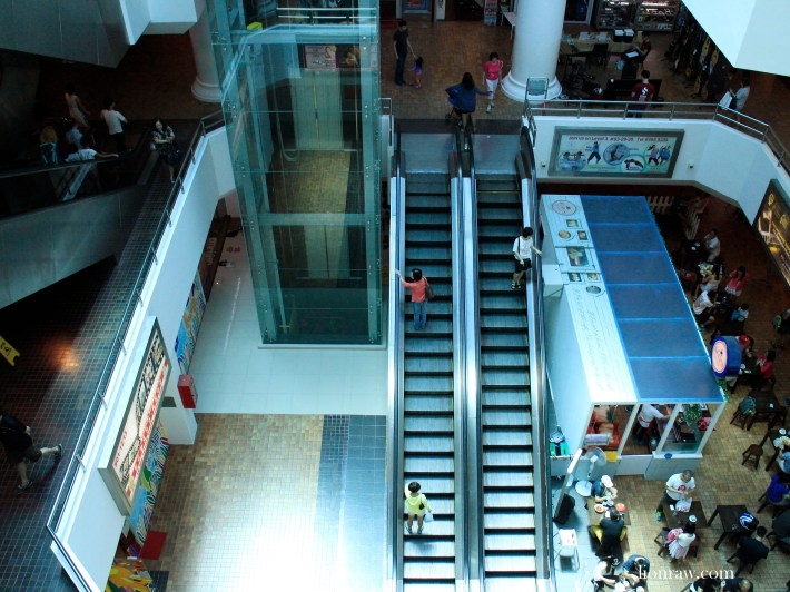 Unlike modern day malls, escalators are given full space and sight, allowing for a beautiful tint of blue to constantly envelope the space on a sunny day.